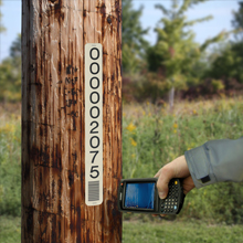 Utility pole markers aid asset management