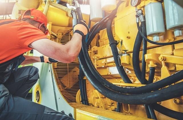 Mechanic repairing equipment part of MRO costs